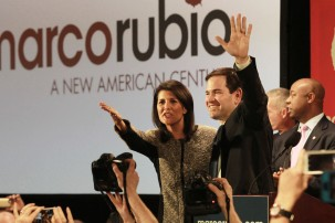 Marco Rubio watch party in Columbia, South Carolina at 807 Bluff Road on Saturday, February 20th. Presidential candidate Marco Rubio waving to the press with South Carolina Governer Nikki Haley who is an open supporter of Rubio. The crowd cheers as Rubio finishes up his speech and poses with Haley.